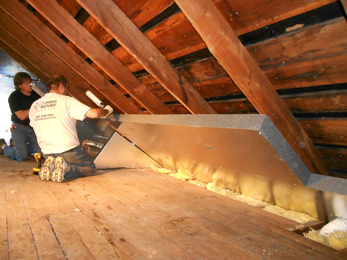 Insulating and sealing an attic with our attic insulation system & SuperAttic™ Attic Insulation in Gainesville Ocala Lady Lake ...